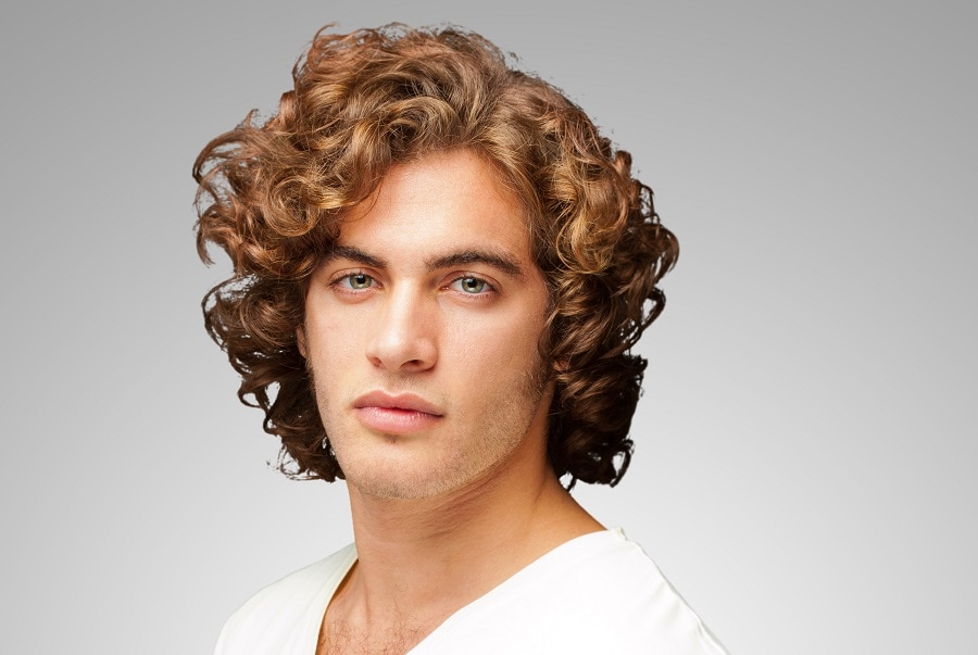 thick curly hairstyle for men