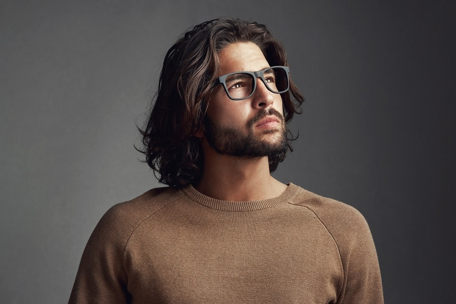 guy with long layered hair and full beard