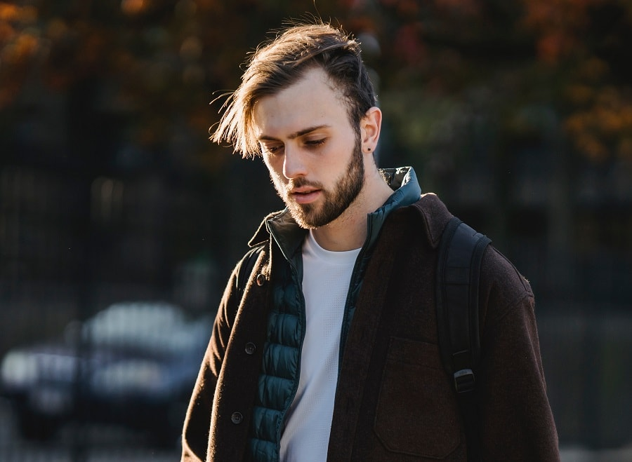 guy with long hair and big forehead