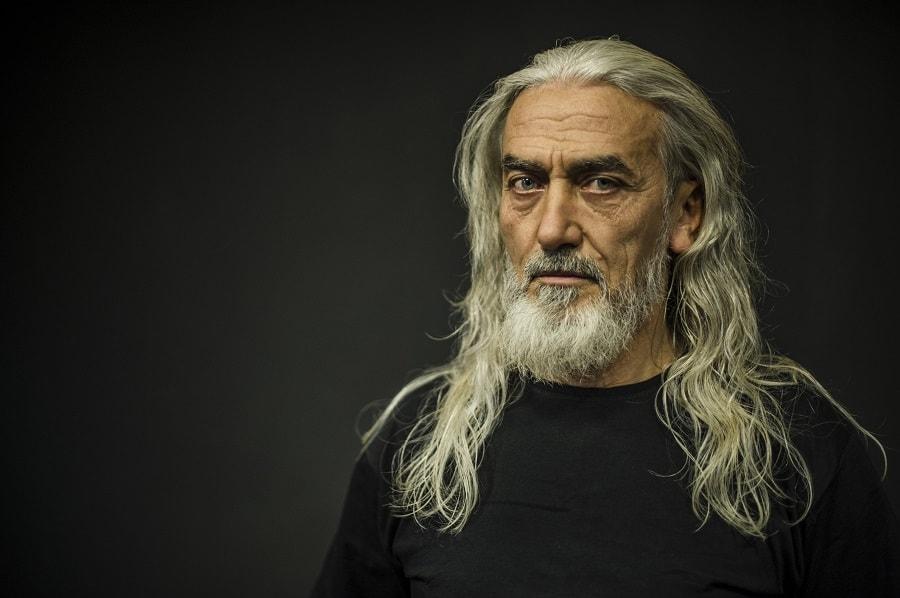 older man with blonde long hair