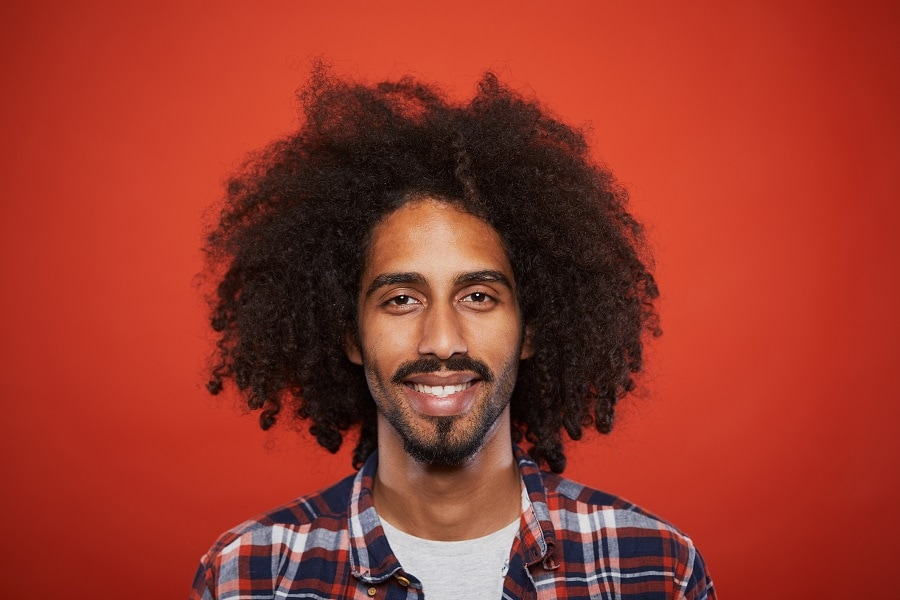 black guy with long afro hair