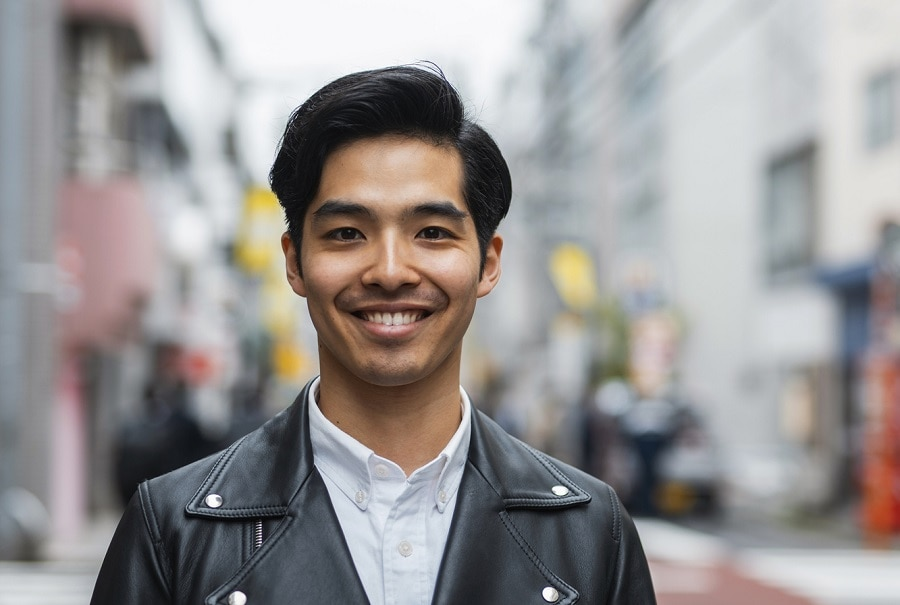 Asian guy with side part hair