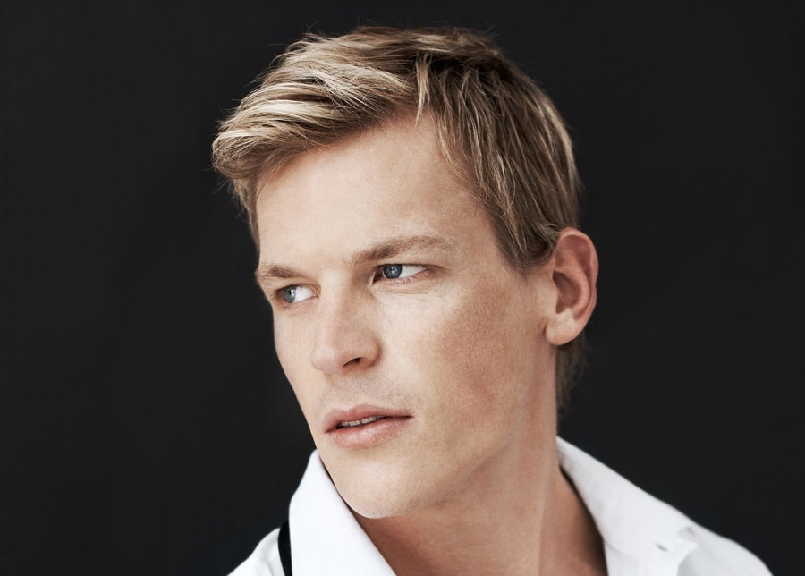 guy with short hair and side part