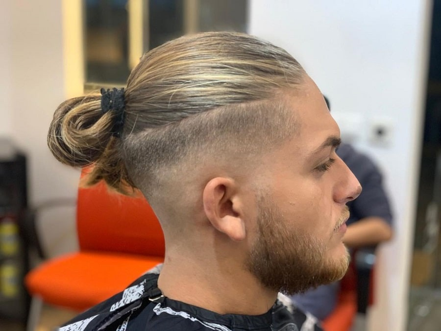 guy with undercut and bun hairstyle