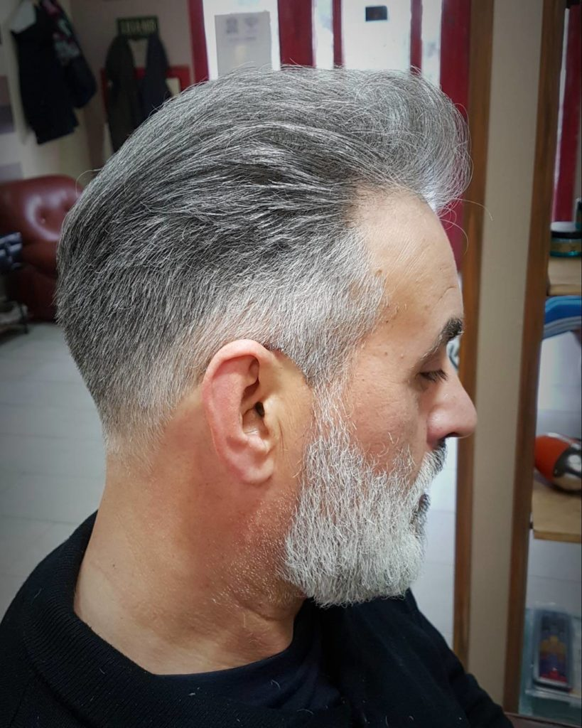 Gray Slick Back Hairstyle For Older Men