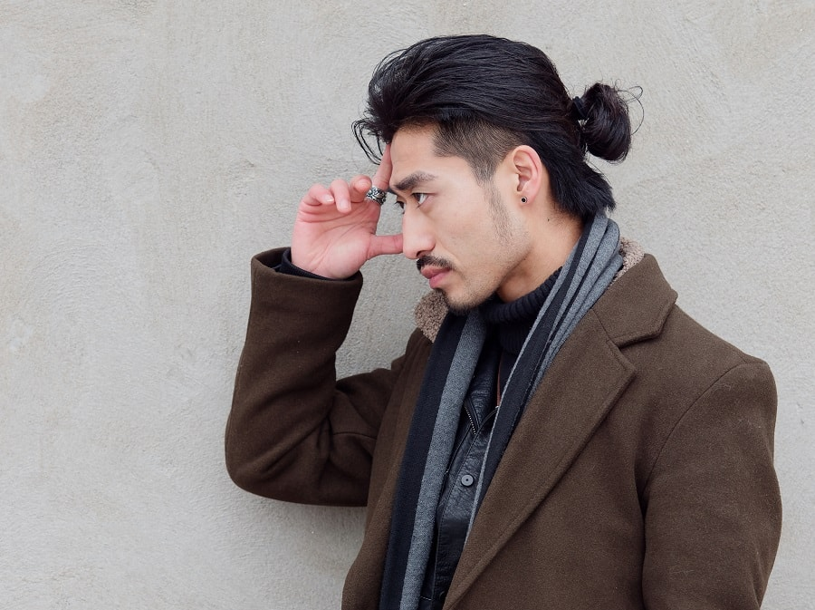 Asian guy with long hair and topknot