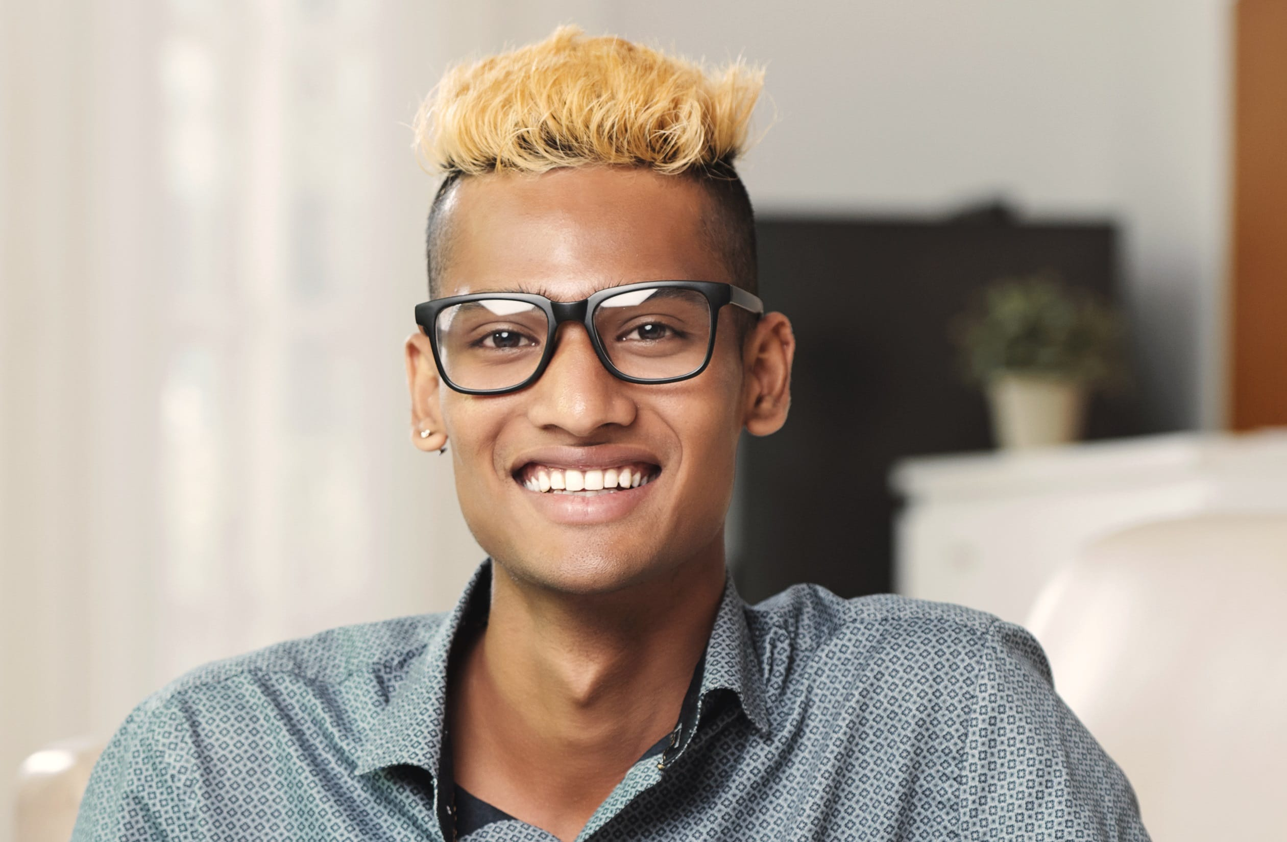 black guy with short blonde hair