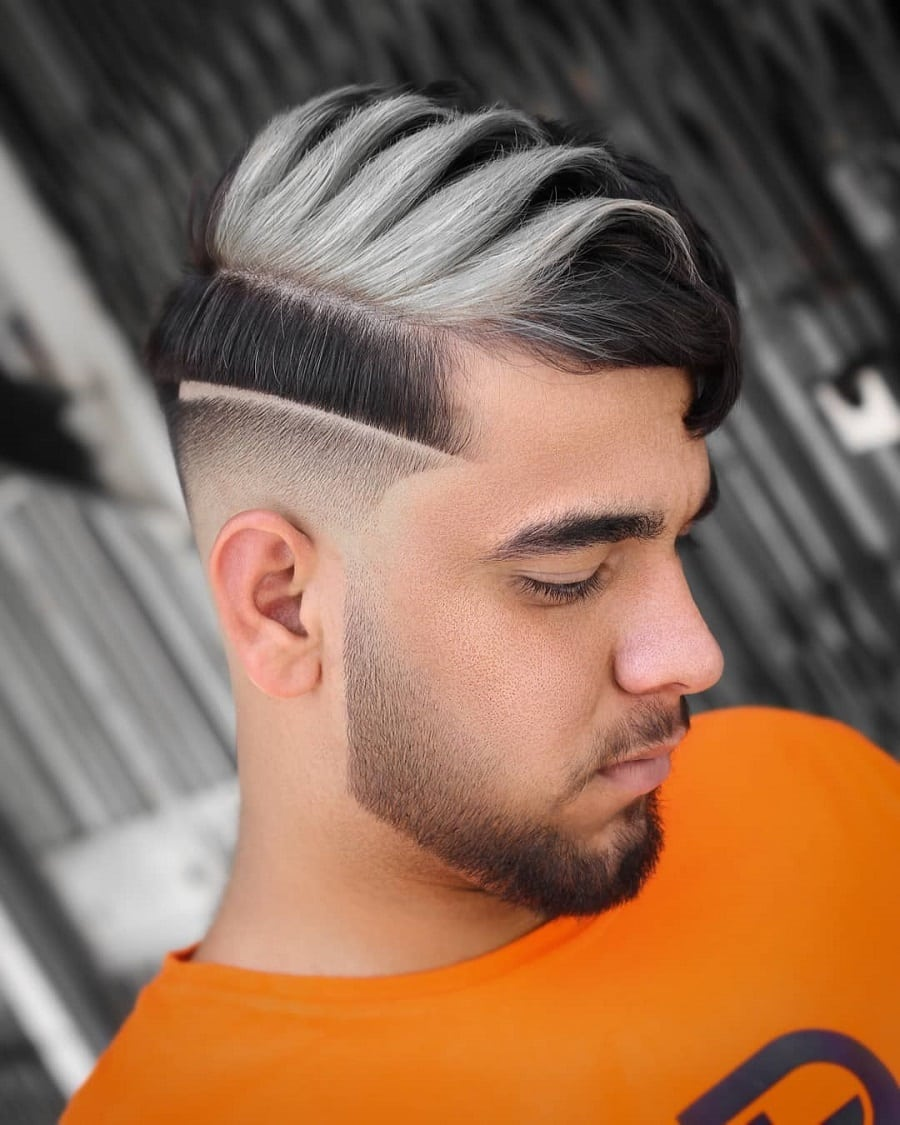 bald fade haircut with silver highlights