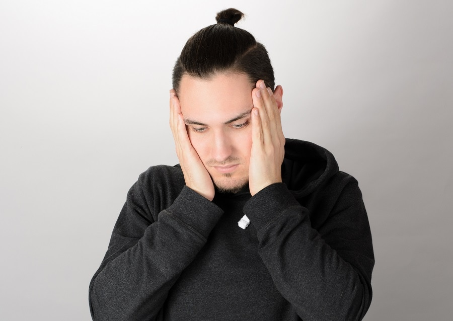 man bun with slick back hairstyle
