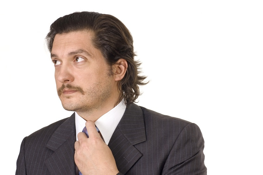 guy with slick back long hair