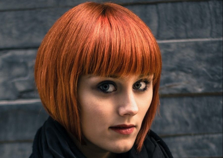 red short bob with thick bangs