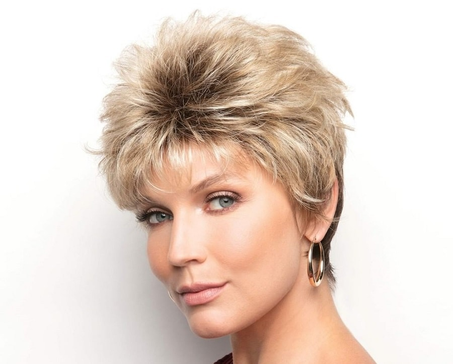 short blonde feathered hair with dark roots