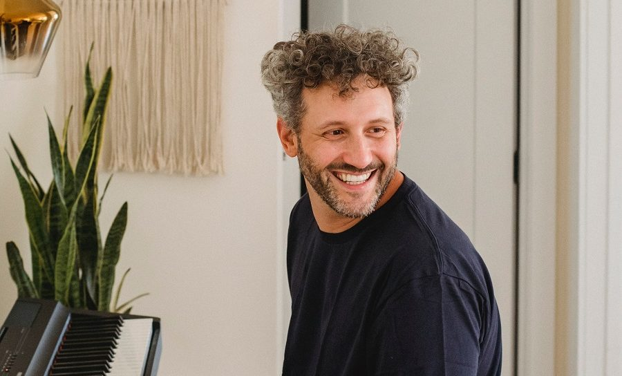 guy over 40 with messy curly hairstyle