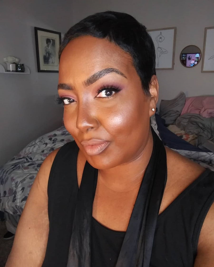black woman with short haircut and double chin