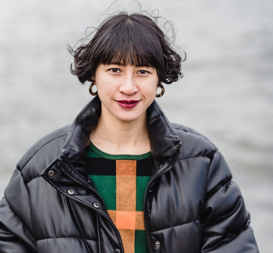 thick curly bob with bangs
