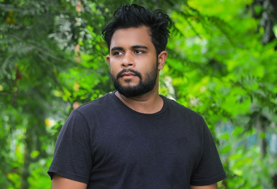 Indian guy with messy hairstyle