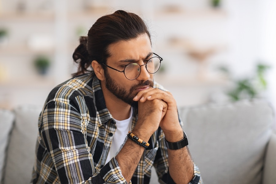 Indian guy with long hairstyle