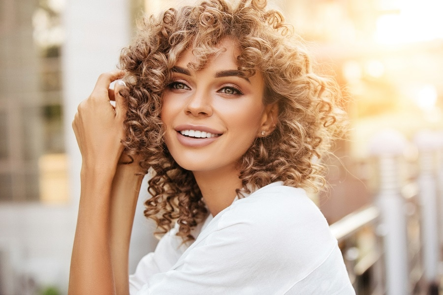 curly hair with blonde highlights