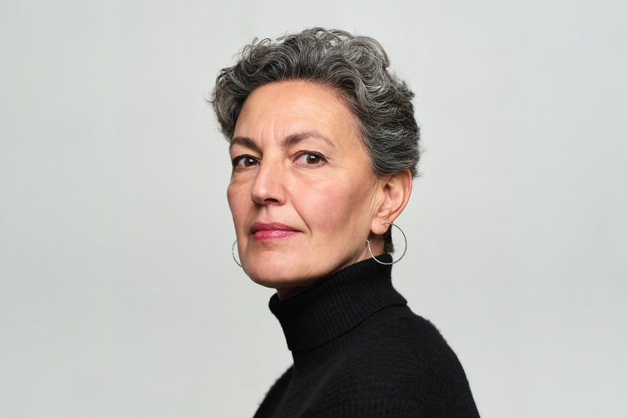 older woman with curly short hair
