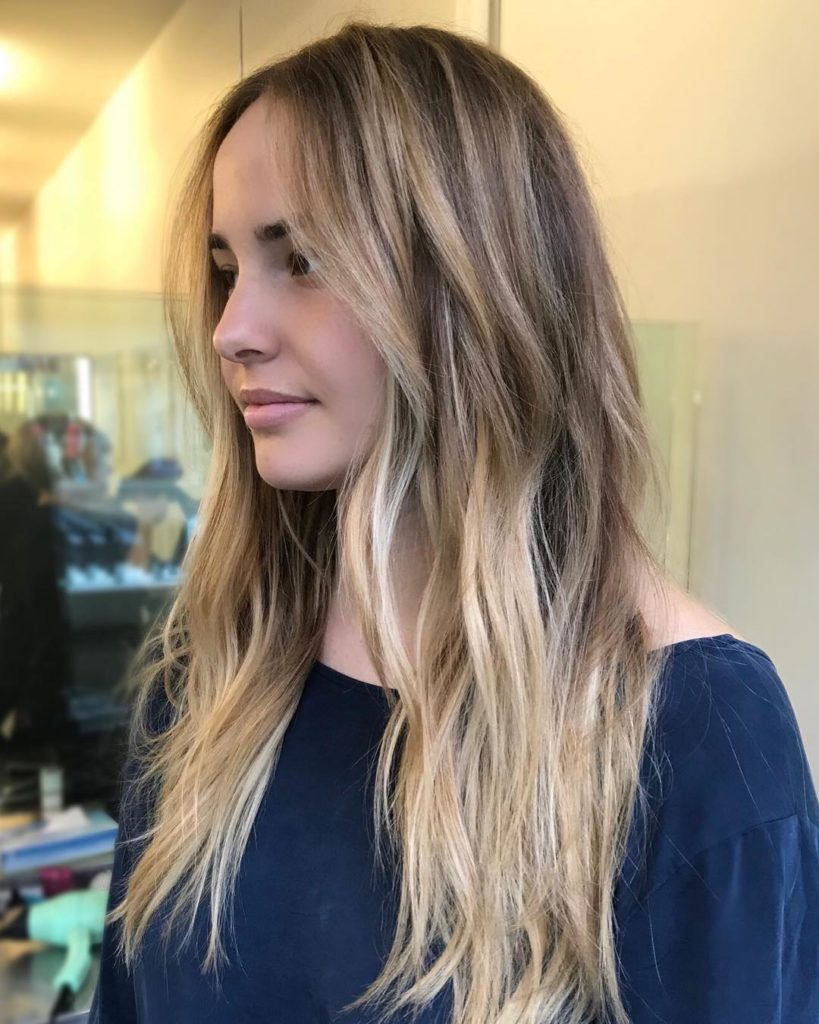 Center Part Hairstyle with Blonde Highlight