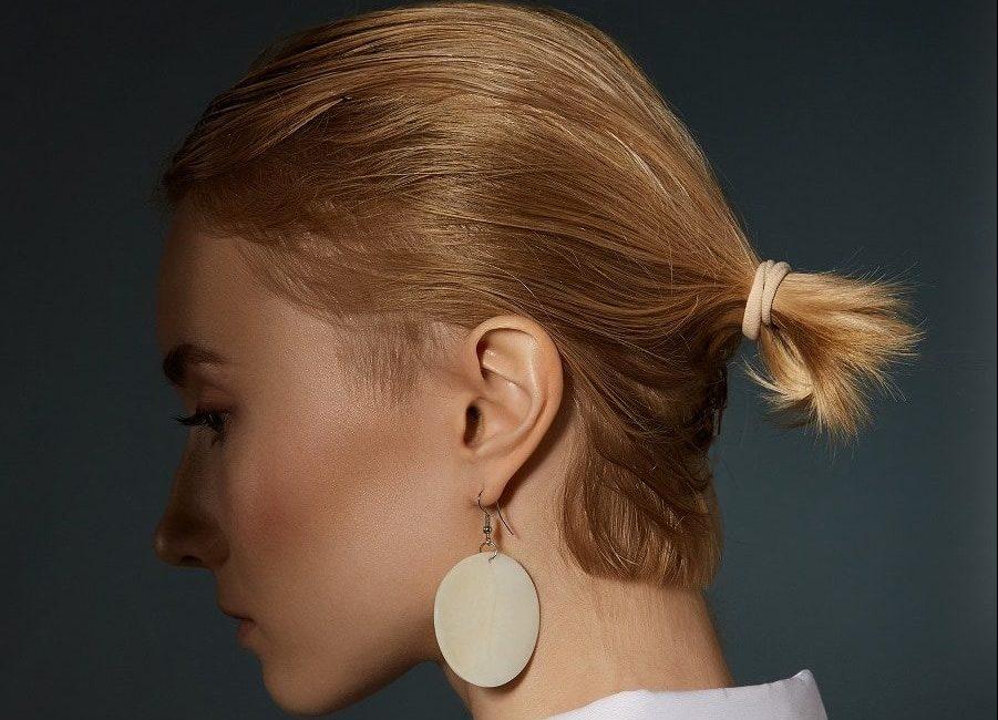 veru short blonde hair with ponytail