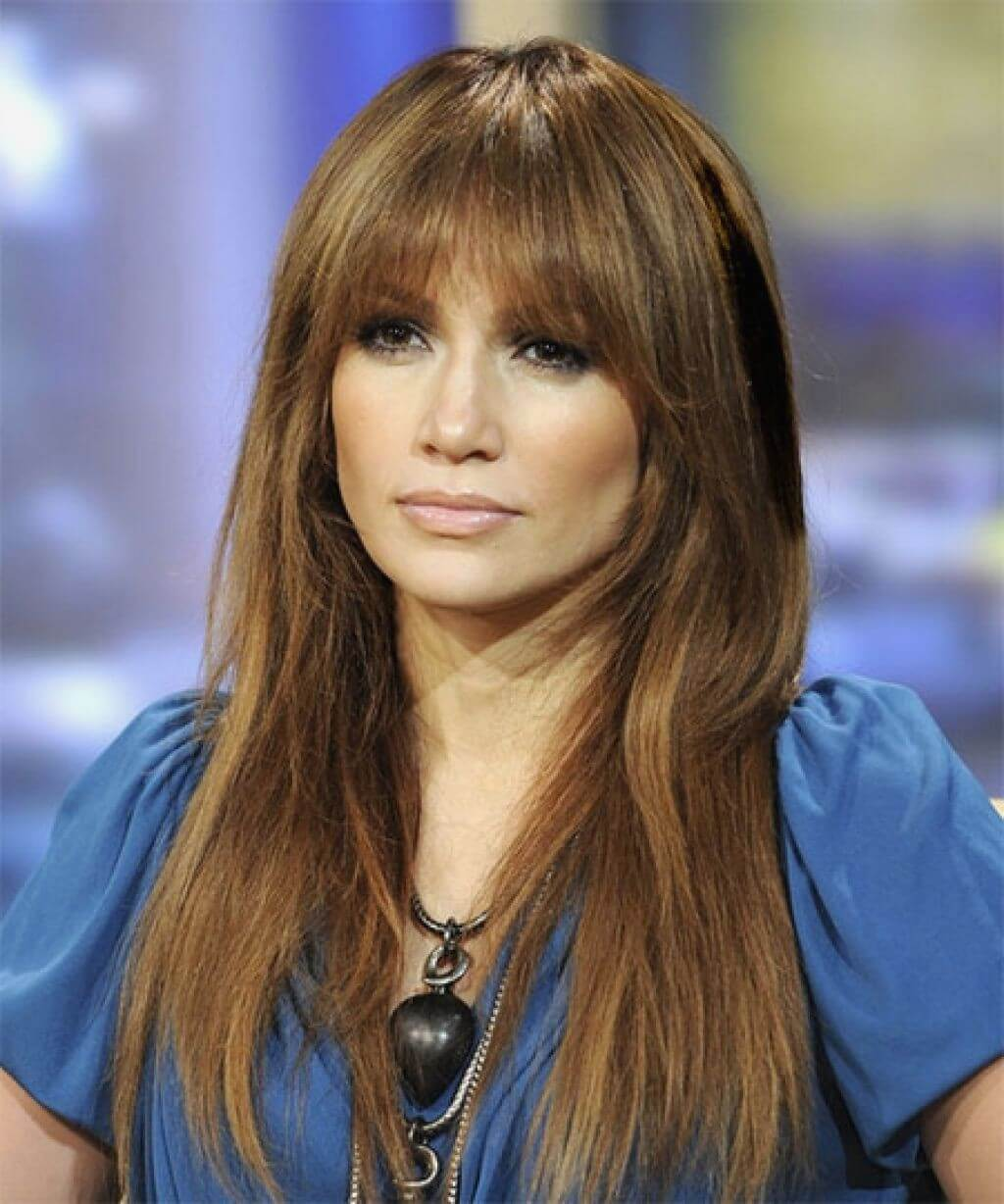 Blunt bangs with straight long hair for medium ash brunette colored hair with dark blonde highlights