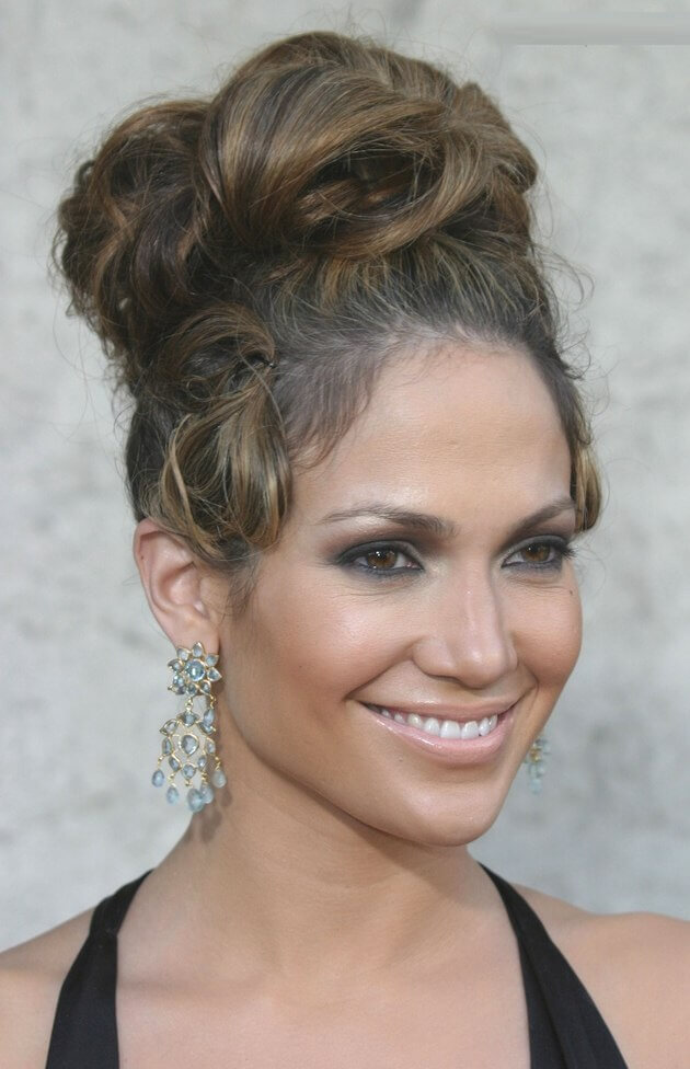 Thick barrel curls into a Updo hairstyle