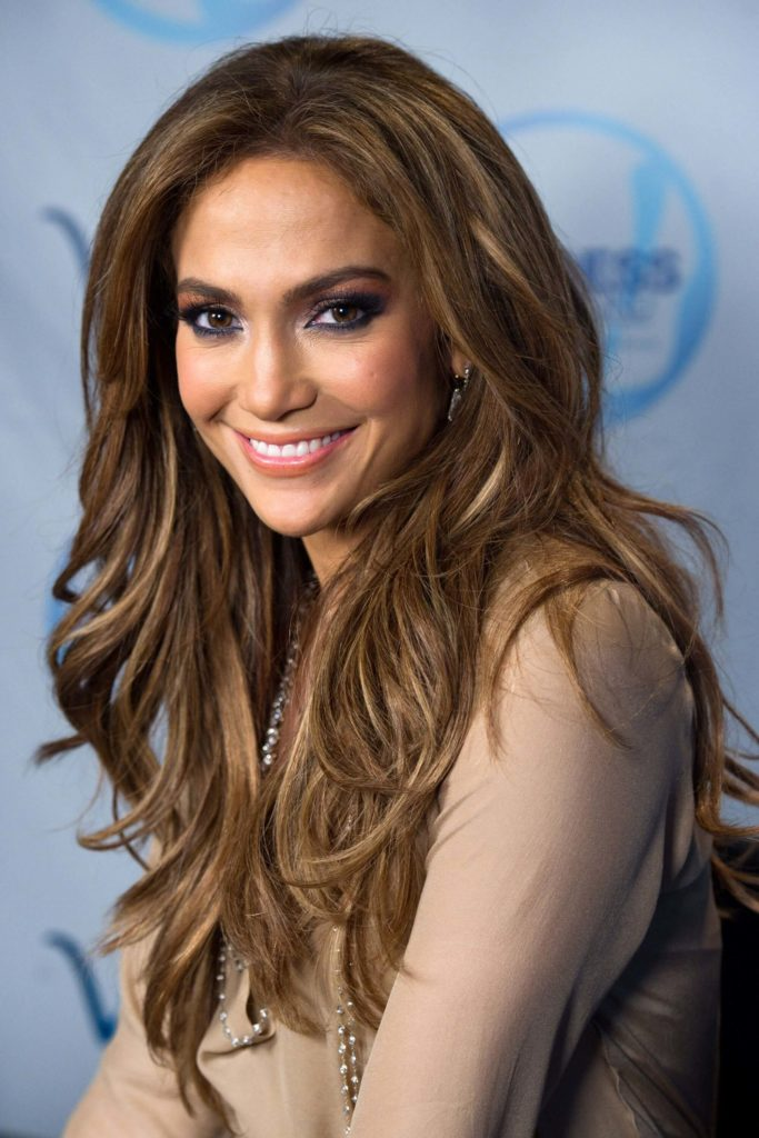 Long waves, middle parting hairstyle for chestnut-colored hair with light blonde highlights