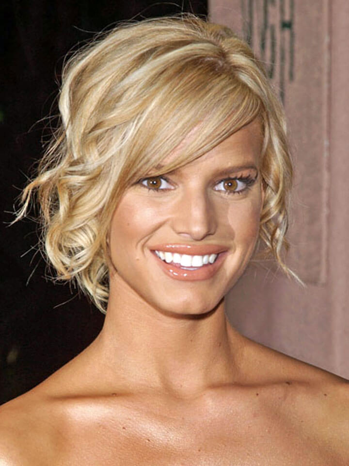 Curly Updo Hairstyle with Side Swept Bangs For Light Blonde Colored Hair