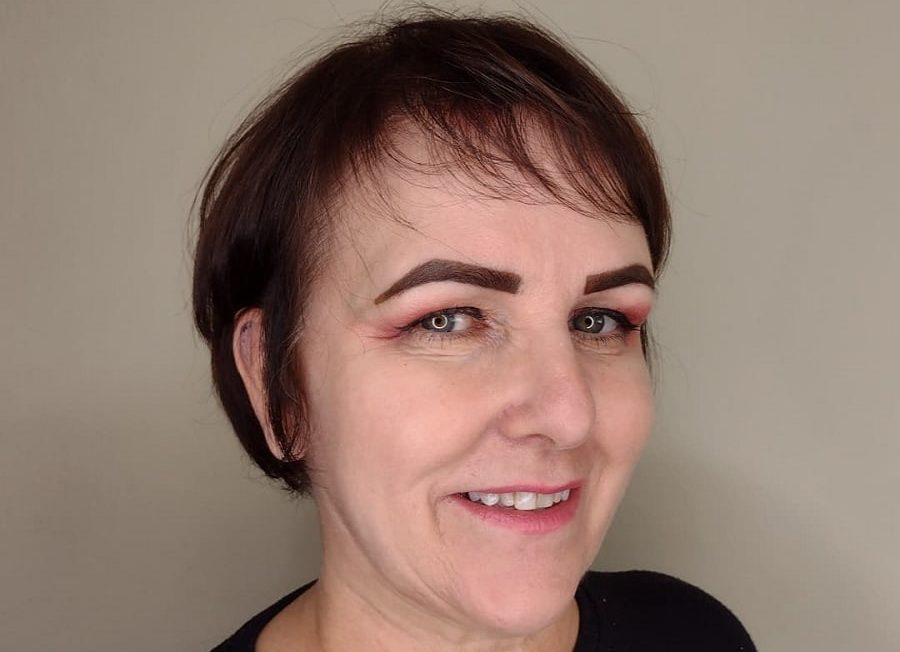 messy pixie with bangs for woman over 50