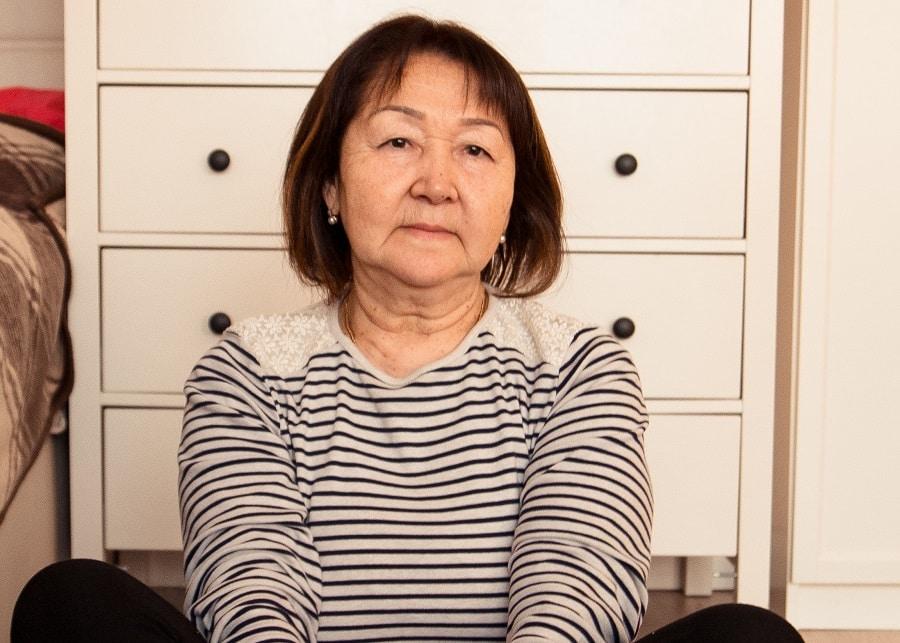 Asian older woman with bob haircut