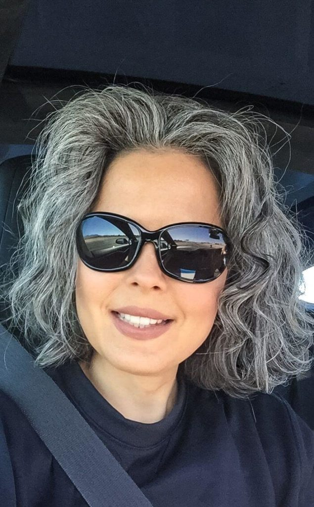 Short hairstyle for natural greying hair