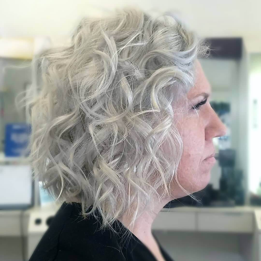 Curly-wavy silver hairstyle