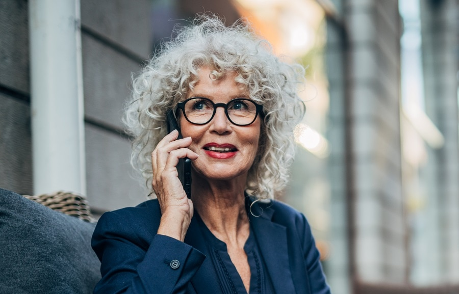 woman over 50 with curly platinum hair