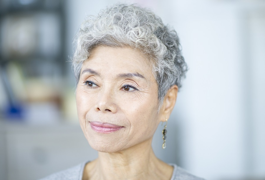 curly pixie hairstyle for women over 50