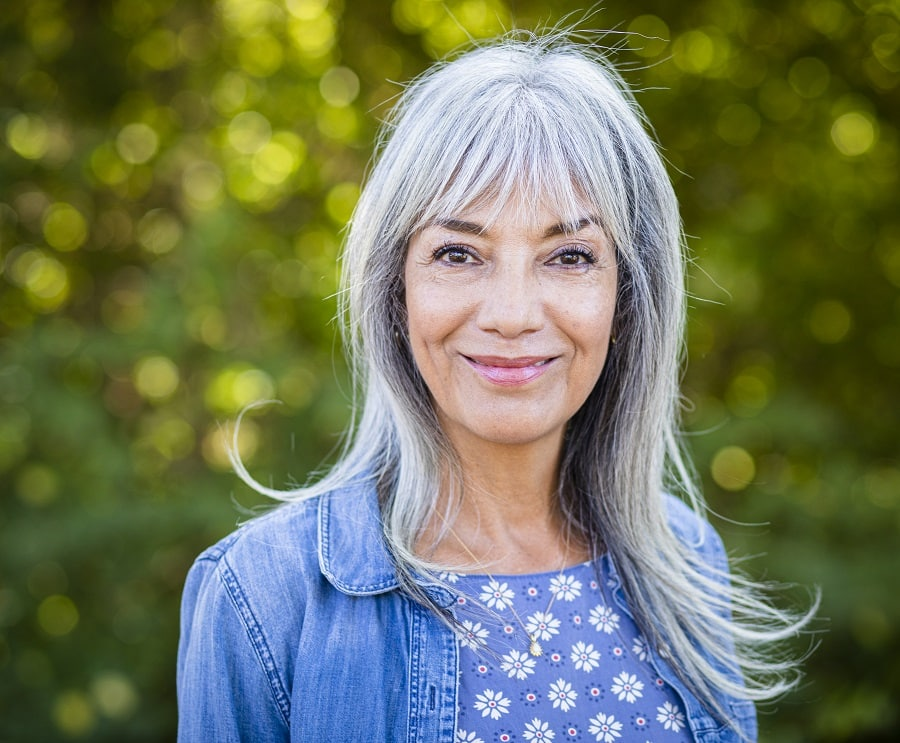 medium gray hairstyle with bangs for women over 50