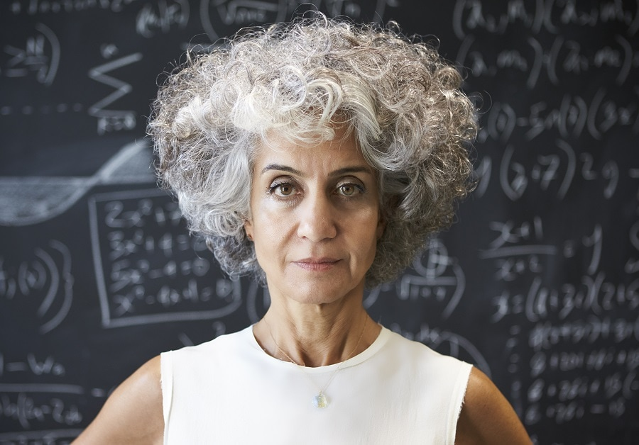 older woman with curly gray hairstyle