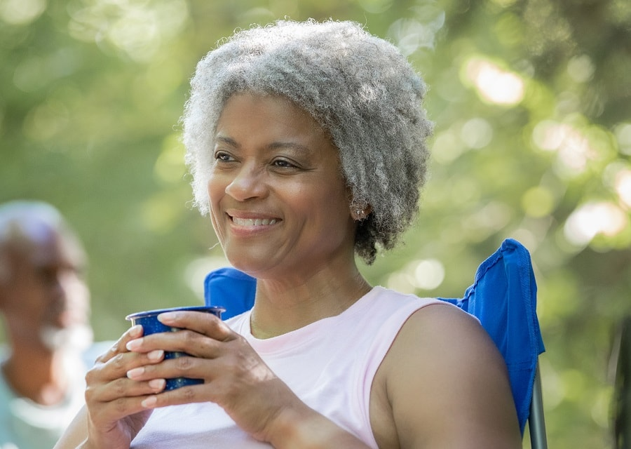 black woman over 50 with afro gray hair
