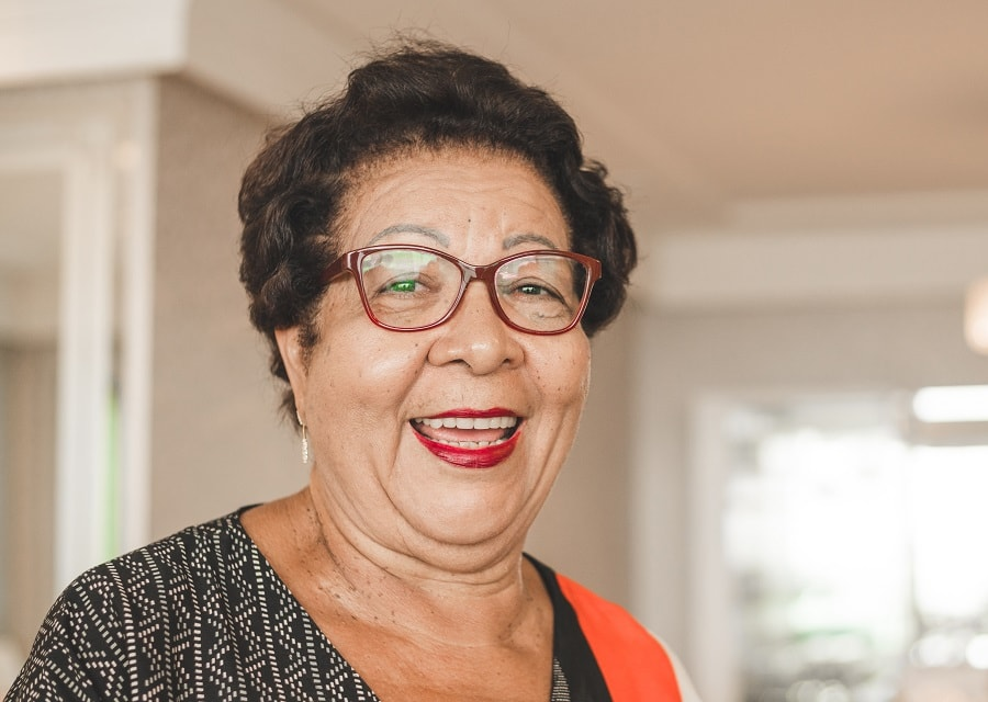 woman over 50 with short hair and double chin