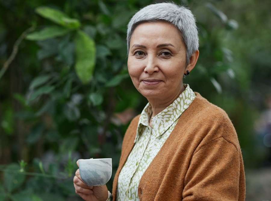 woman over 50 with round face and gray short hair