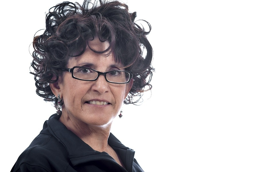 curly layered hairstyle for women over 50