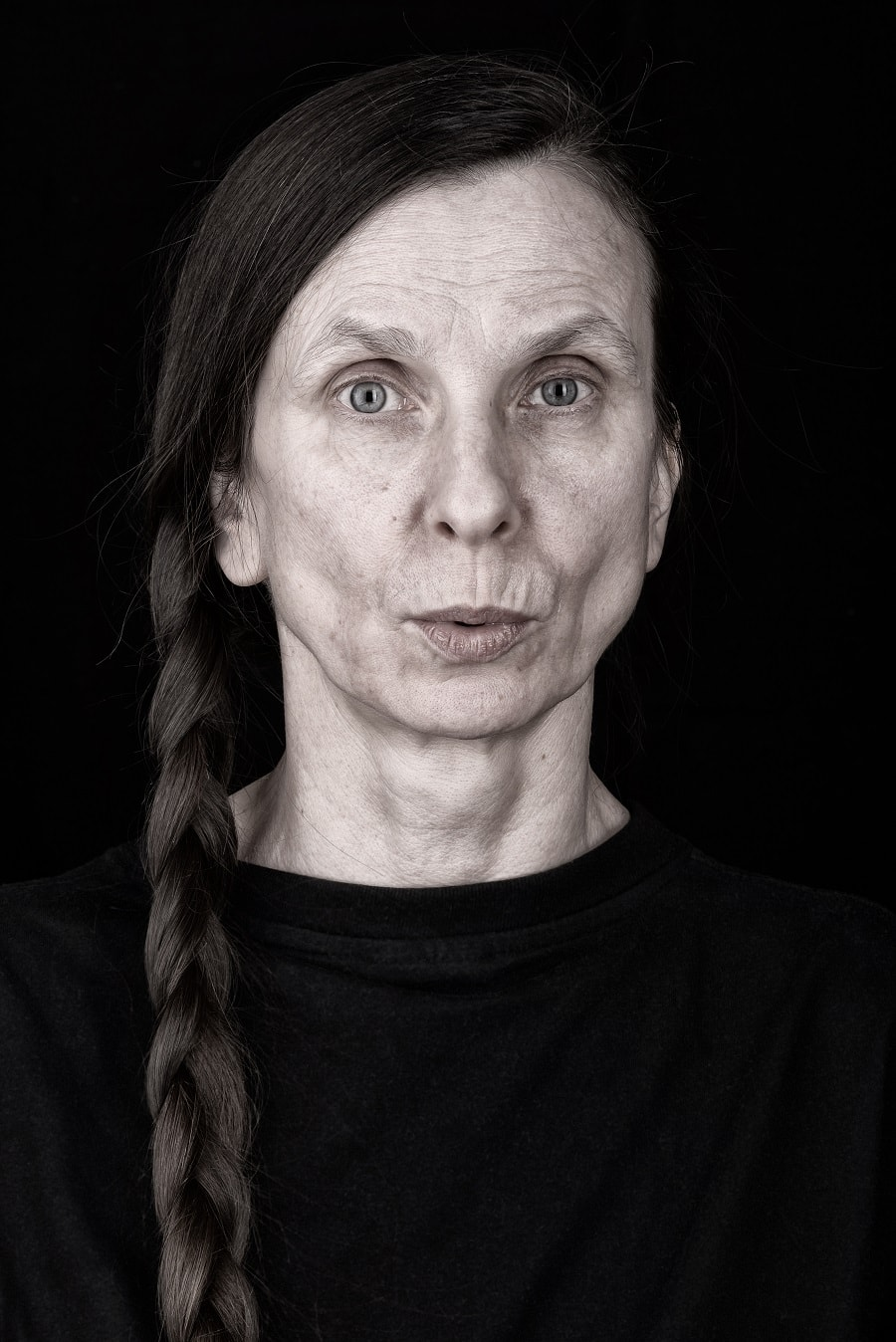 woman over 50 with long braids
