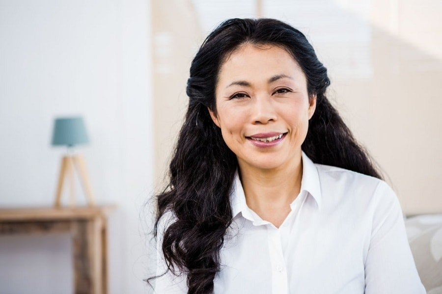 Asian woman over 50 with thick long hair