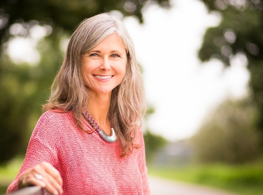 woman over 50 with long gray hair