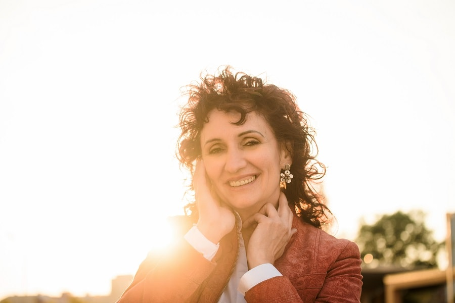 medium length curly layered hairstyle for women over 50