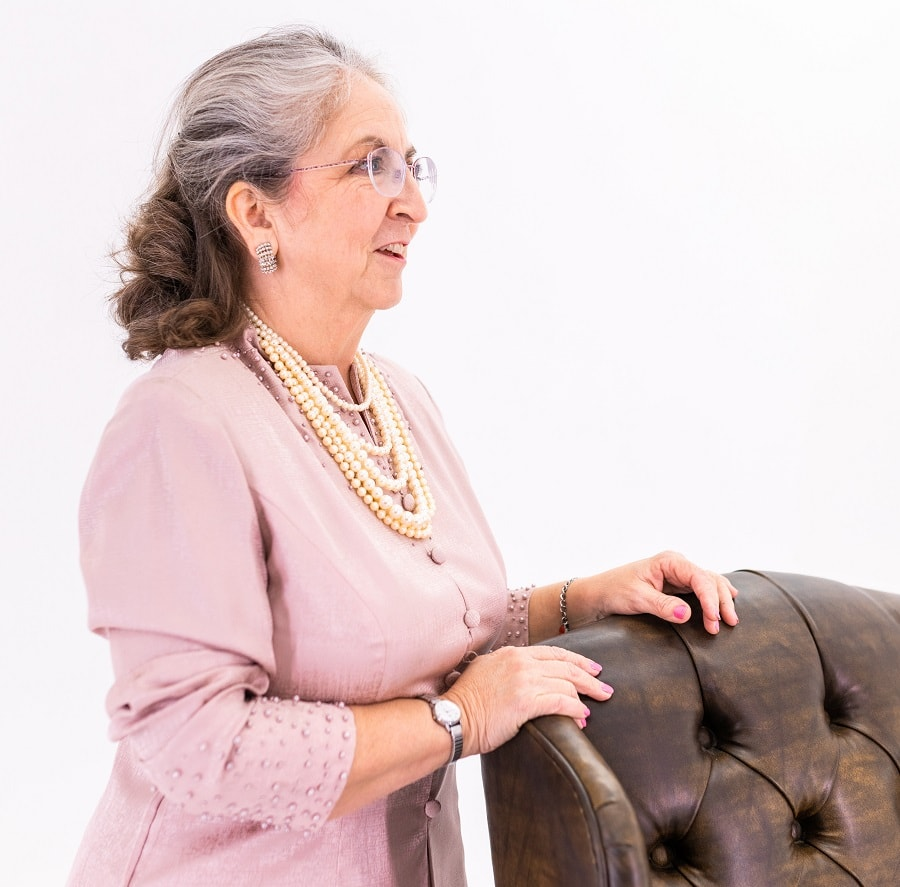 woman over 50 with shoulder length hair