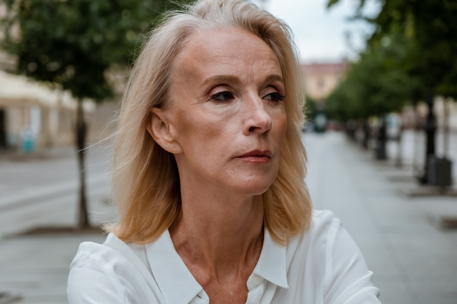 woman over 50 with blonde hairstyle