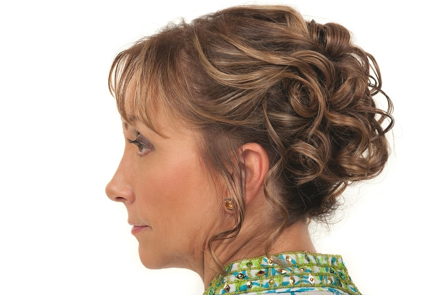 curly updo with bangs for older women