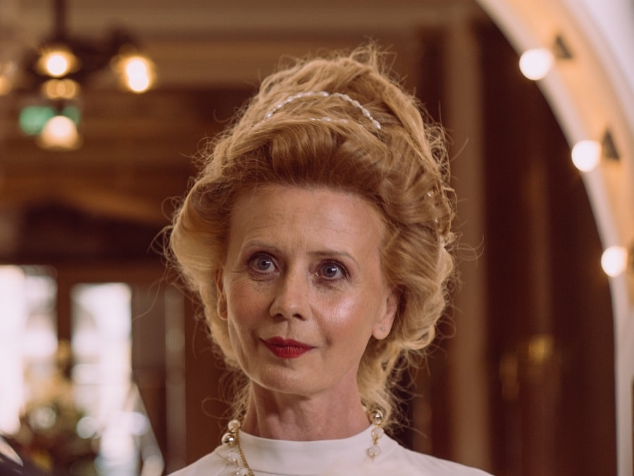 woman over 50 with updo hairstyle