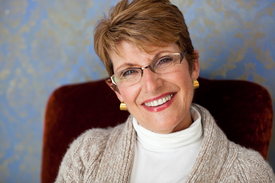 woman over 50 with short brown pixie